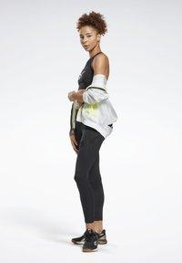 Reebok - WORKOUT READY HIGH NECK SPORTS BRA - Light support sports bra - black - 1