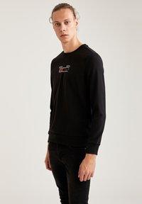 DeFacto - Sweatshirt - black - 0