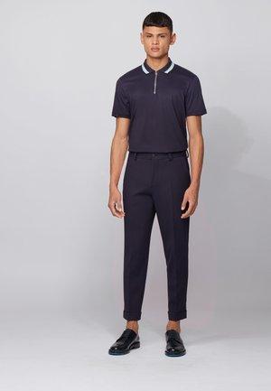 PARAS 06 - Polo shirt - dark blue