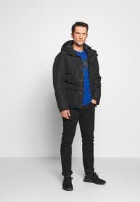 s.Oliver - Slim fit jeans - black denim - 1