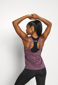 Under Armour - FLY BY TANK - T-shirt de sport - purple - 2