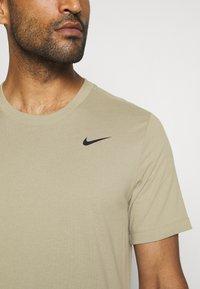 Nike Performance - DRY TEE CREW SOLID - Basic T-shirt - mystic stone/black - 6