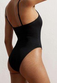 OYSHO - SEAMLESS OTTOMAN - Swimsuit - black - 3