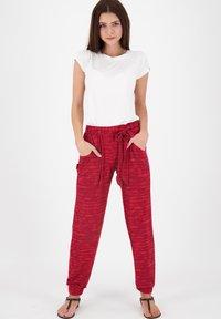 alife & kickin - ALICEAK - Trousers - cranberry - 1
