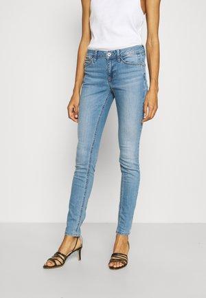 JONA - Jeans Skinny Fit - used light stone blue denim