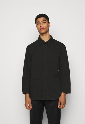 EXCURSION UNISEX - Lett jakke - black