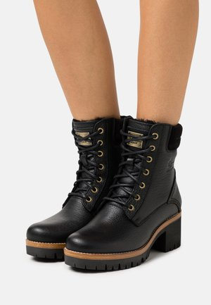 PHOEBE IGLOO - Lace-up ankle boots - black