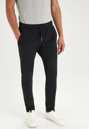 Pantalones deportivos - black