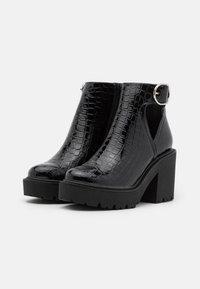 Topshop - BRYCE CUT OUT UNIT - Platform ankle boots - black - 1