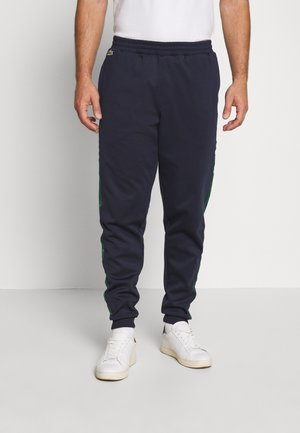Tracksuit bottoms - dark navy blue/green