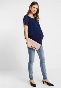 MAMALICIOUS - MLGOLDEN - Slim fit jeans - light blue denim - 1