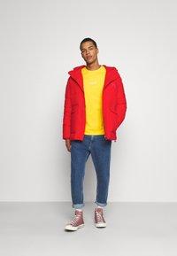 Calvin Klein Jeans - ECO JACKET - Winter jacket - red hot - 1
