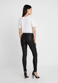 ONLY - ONLNEW ROYAL - Pantalones - black - 2