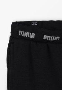 Puma - AMPLIFIED SWEAT PANTS - Tracksuit bottoms - black - 2