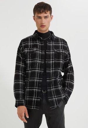 JONTE - Light jacket - black/white