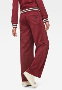G-Star - LUCAY WIDE TRACK PANT WMN - Trousers - port red - 1