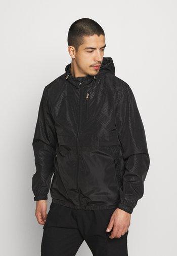 REGIO WINDRUNNER - Summer jacket - black