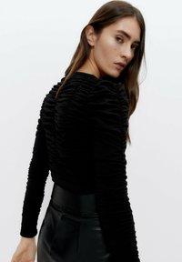 Uterqüe - Long sleeved top - black - 2