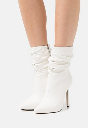BELLO - Classic ankle boots - white