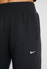 Nike Performance - YOGA PANT CROP - 3/4 sports trousers - black/white - 4
