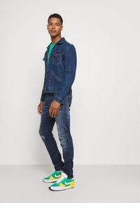 Replay - ANBASS HYPERFLEX REUSED X LITE - Jeans Tapered Fit - dark blue denim - 3