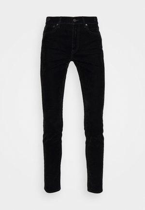 MR SKI SKINNY - Trousers - flocked black