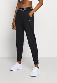 Calvin Klein Performance - Tracksuit bottoms - black - 0
