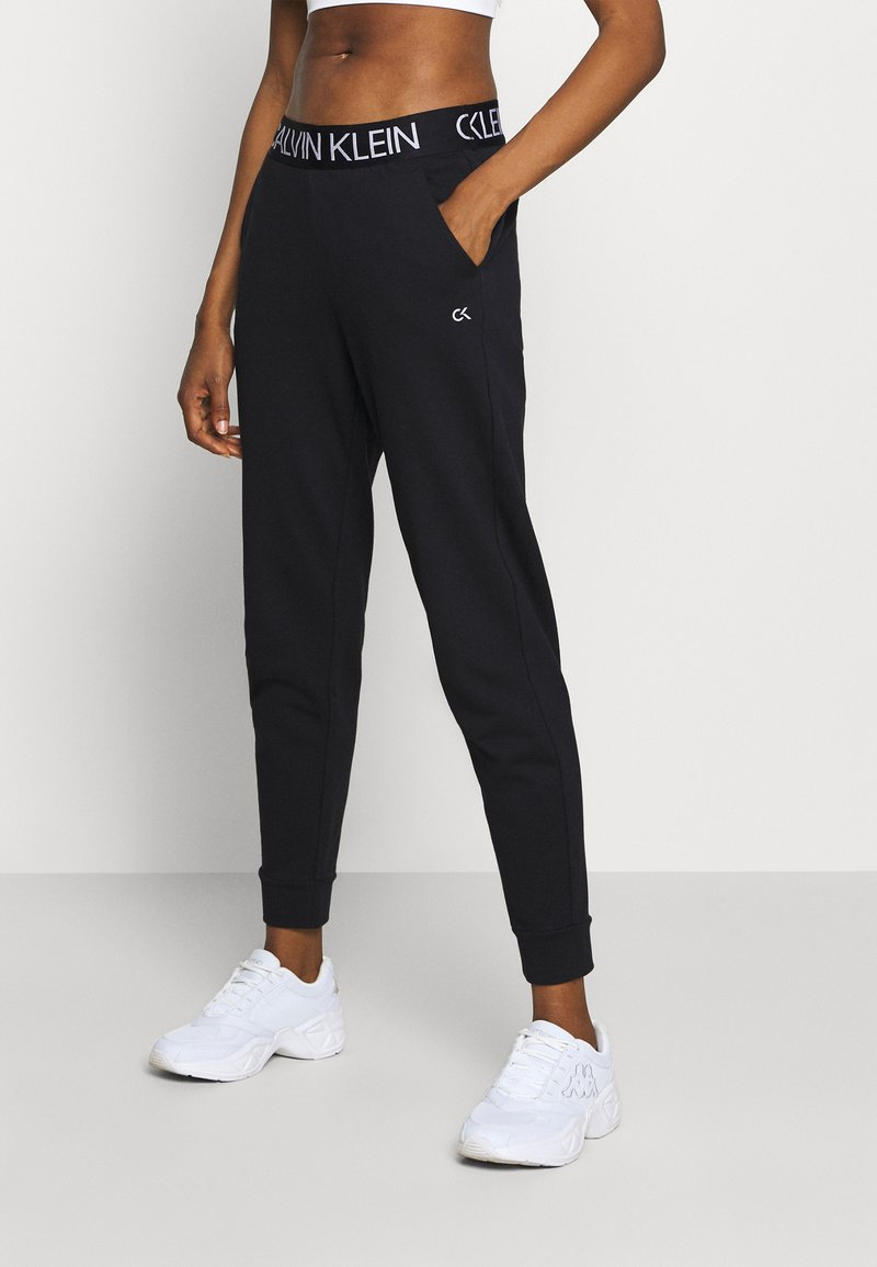 Calvin Klein Performance - Tracksuit bottoms - black