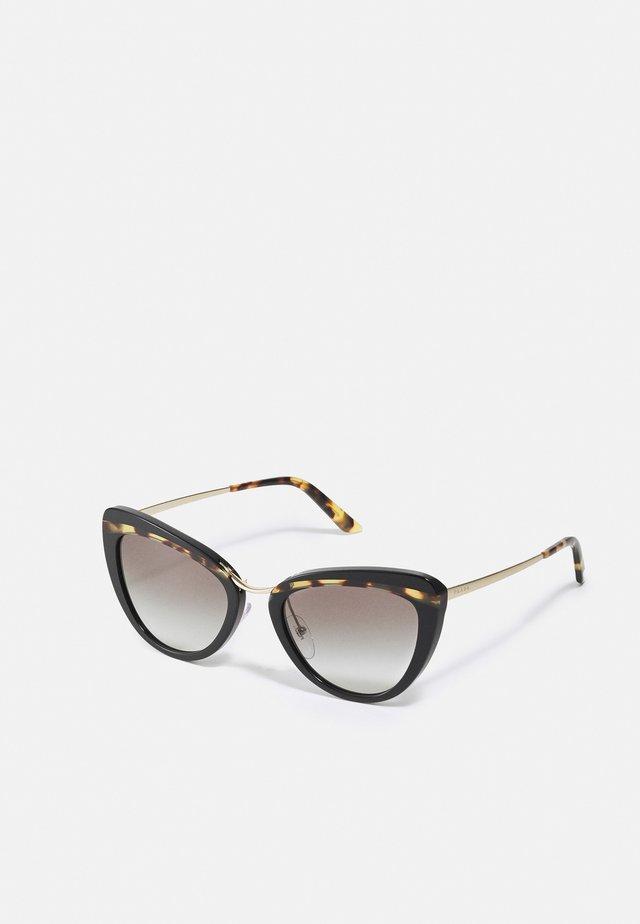 Sonnenbrille - pale gold