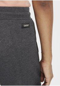Oxmo - GABRILLA - Tracksuit bottoms - dark grey melange - 4