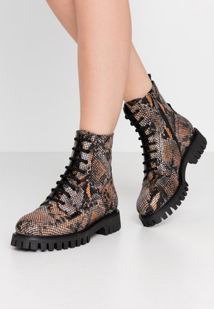 Lace-up ankle boots - orange