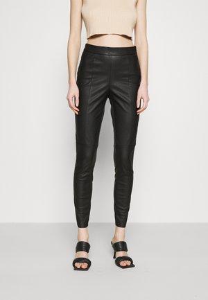 JDYSAHARA - Leggings - Trousers - black