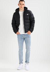 adidas Performance - HELIONIC DOWN JACKET - Winter jacket - black - 1