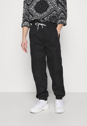 REGULAR UTILITY JOGGER - Tracksuit bottoms - black