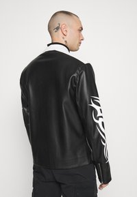 Jaded London - TRIBAL MOTORCROSS VEGAN JACKET - Faux leather jacket - black/white - 2