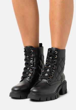 VEGAN PUFFED - Platform ankle boots - black