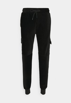 ESSENTIAL - Tracksuit bottoms - black/orange