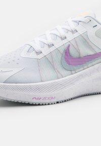 Nike Performance - WINFLO 8 - Neutral running shoes - white/infinite lilac/football grey/violet shock/green glow/laser orange - 5