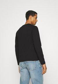 Calvin Klein - TEXT REVERSED LOGO - Maglietta a manica lunga - black - 2