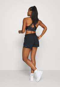 Under Armour - PROJECT ROCK TRAIN SHORTS - Sports shorts - black/summit white - 2