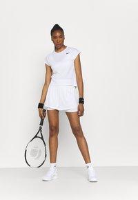 Nike Performance - T-shirts - white/black - 1