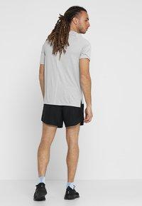 Nike Performance - CHALLENGER SHORT - Sports shorts - black/silver - 2