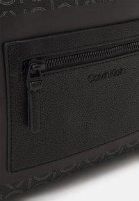 Calvin Klein - CAMERA BAG MONO UNISEX - Across body bag - black - 3