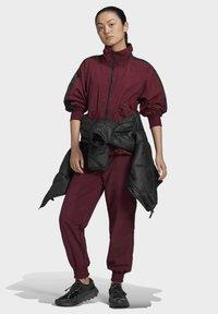 adidas by Stella McCartney - CF MACCARTNEY TRAINING WORKOUT PANTS - Pantalones deportivos - burgundy - 1