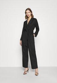 Monki - KATRINE SUITINS - Overall / Jumpsuit - black solid - 0