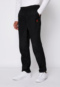 Calvin Klein Jeans - SEAMED PANT - Trousers - black - 0