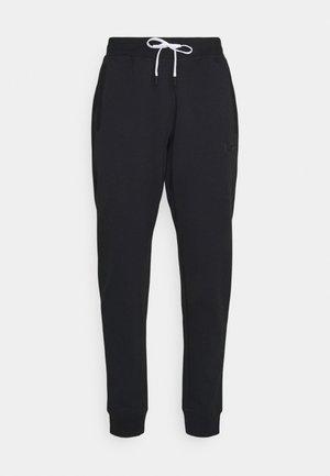 STATUS PANTS - Tracksuit bottoms - black