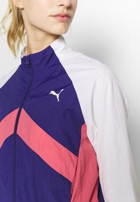Puma - STUDIO CLASH ACTIVE TRACK JACKET - Treningsjakke - purple