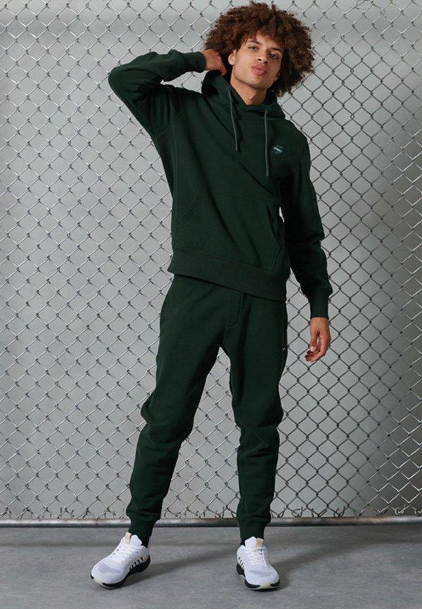 Superdry Spodnie treningowe - academy dark green/zielony Odzież Męska JLVR