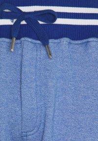 Schott - PAUL - Tracksuit bottoms - heather blue - 5